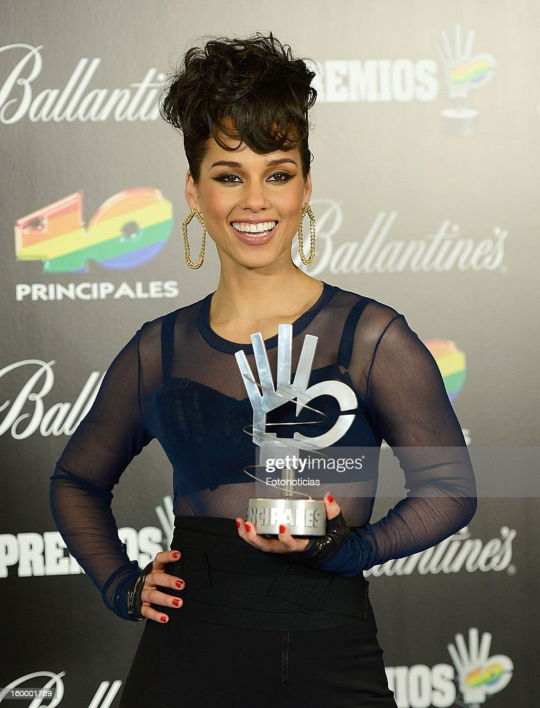 <a gi-track='captionPersonalityLinkClicked' href=/galleries/search?phrase=Alicia+Keys&family=editorial&specificpeople=169877 ng-click='$event.stopPropagation()'>Alicia Keys</a> poses in the press room during '40 Principales Awards' 2012 at the Palacio de Deportes on January 24, 2013 in Madrid, Spain.