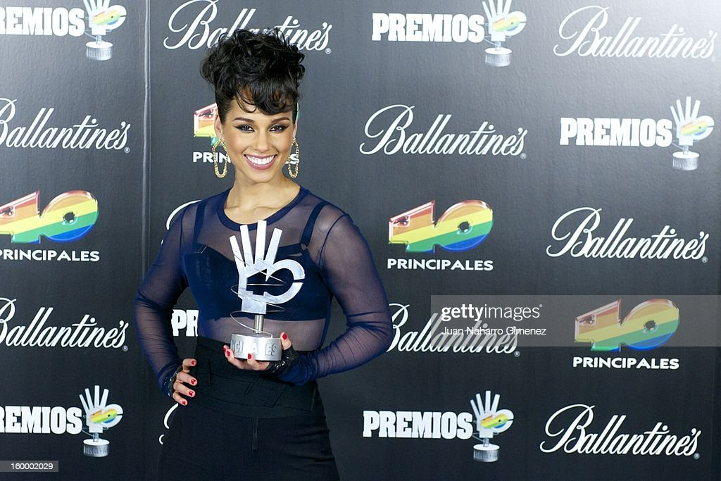 <a gi-track='captionPersonalityLinkClicked' href=/galleries/search?phrase=Alicia+Keys&family=editorial&specificpeople=169877 ng-click='$event.stopPropagation()'>Alicia Keys</a> poses in the press room during 40 Principales Awards 2012 at the Palacio de Deportes on January 24, 2013 in Madrid, Spain.