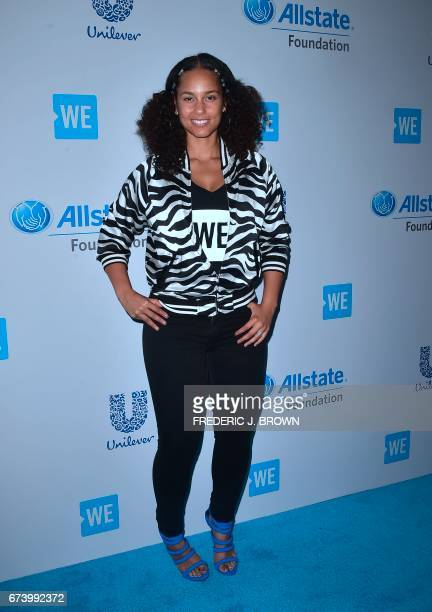 Alicia Keys poses on arrival at We Day 2017 in Inglewood California on April 27 2017 / AFP PHOTO / FREDERIC J BROWN