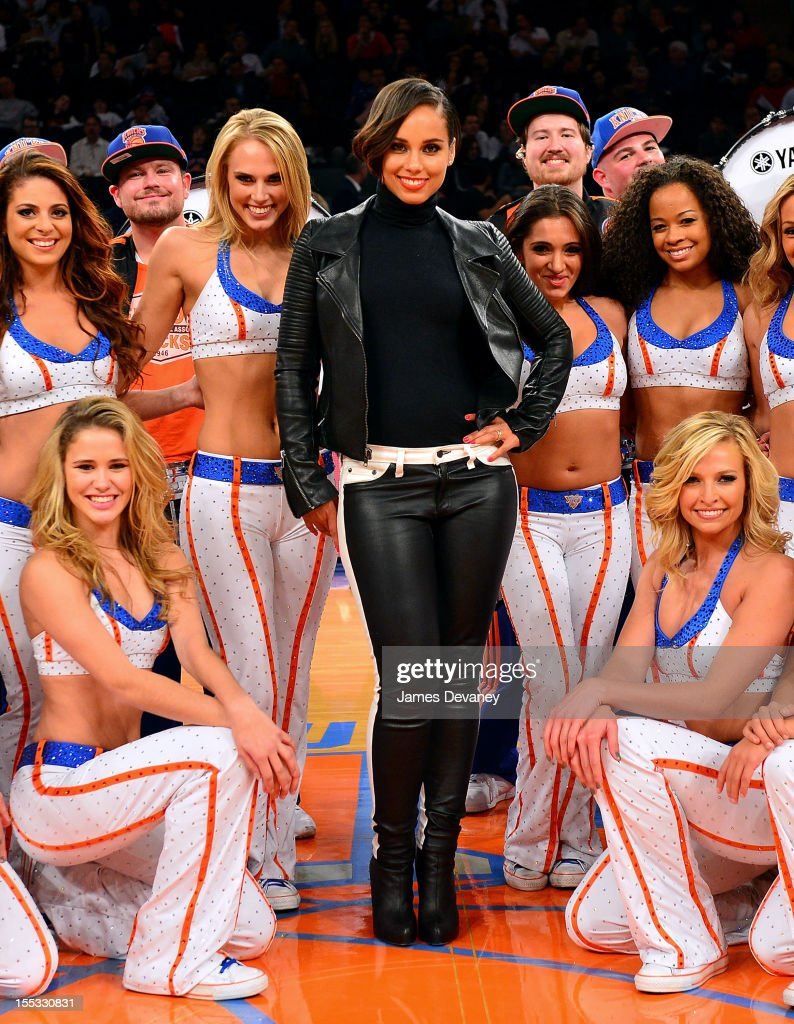 <a gi-track='captionPersonalityLinkClicked' href=/galleries/search?phrase=Alicia+Keys&family=editorial&specificpeople=169877 ng-click='$event.stopPropagation()'>Alicia Keys</a> poses with Knicks City Dancers at half-time of the Miami Heat vs New York Knicks game at Madison Square Garden on November 2, 2012 in New York City.