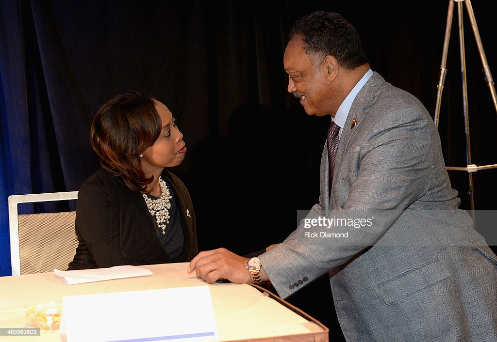 Alicia Matthews of St. Jude Children's Research Hospital (L) and Reverend Jesse Jackson attend the Super Bowl Gospel Celebration press conference at Super Bowl XLVIII Media Center, Sheraton Times Square on January 30, 2014 in New York City.