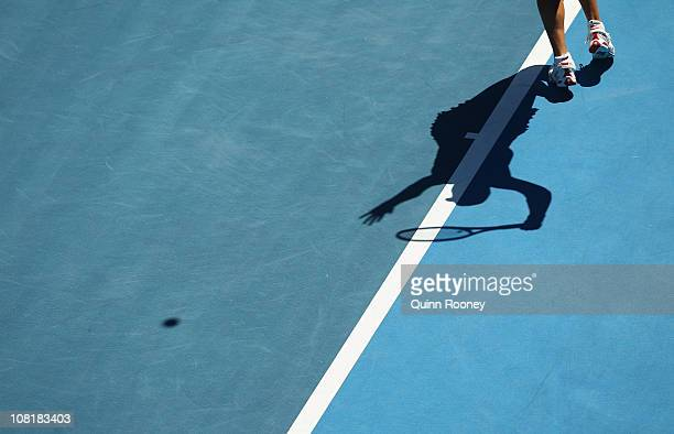 Alicia Molik of Australia serves in her second round match against Nadia Petrova of Russia during day four of the 2011 Australian Open at Melbourne...