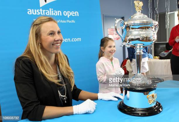 Alicia Molik poses for a photo with a young tennis player and a replica of the Daphne Akhurst Memorial Cup during the Australian Open Trophy Tour at...