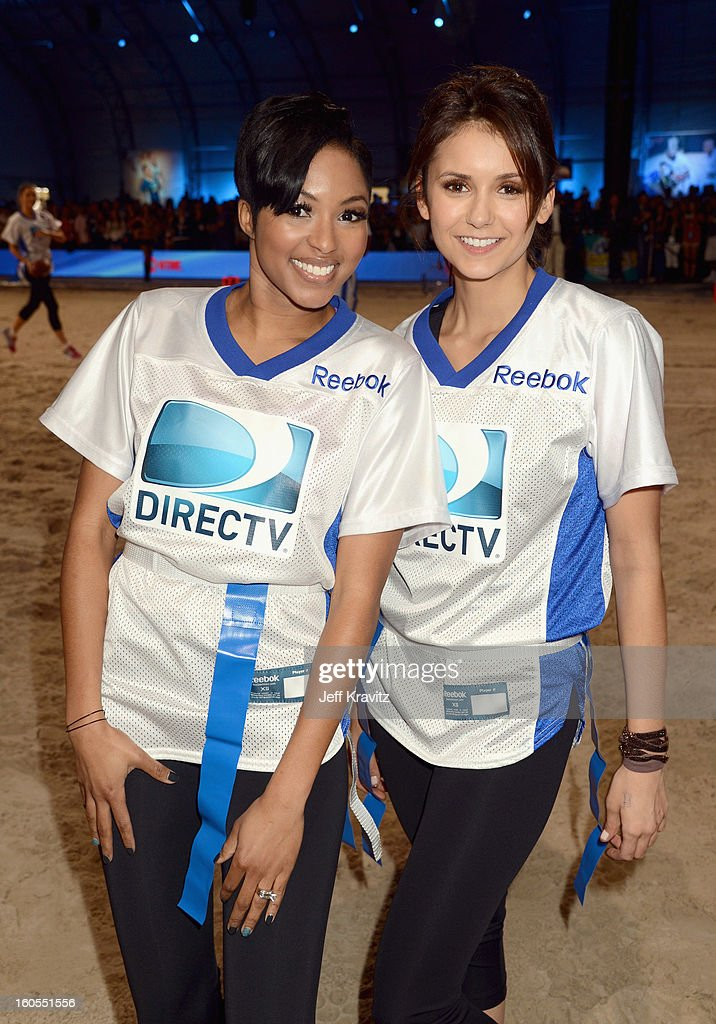 Alicia Quarles (L) and Nina Dobrev attend DIRECTV'S 7th Annual Celebrity Beach Bowl at DTV SuperFan Stadium at Mardi Gras World on February 2, 2013 in New Orleans, Louisiana.