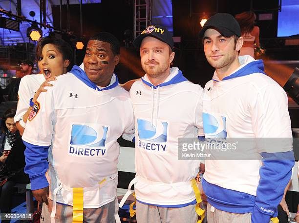 Alicia Quarles Tracy Morgan Aaron Paul and Chace Crawford participate in the DirecTV Beach Bowl at Pier 40 on February 1 2014 in New York City