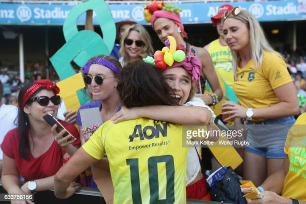 Alicia Quirk of Australia is comforted by supporters in the crowd after losing the womens bronze cup match between New Zealand and Australia in the...