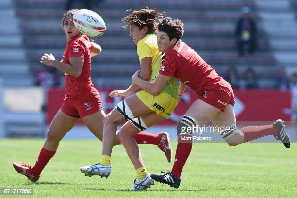 Alicia Quirk of Australia is tackled by Brittany Benn of Canada during the HSBC World Rugby Women's Sevens Series 2016/17 Kitakyushu semi final...