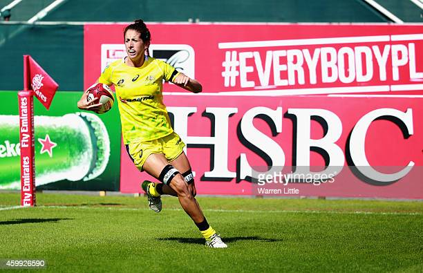 Alicia Quirk of Australia scores a try against South Africa during the IRB Women's Sevens Rugby World Series at the Emirates Dubai Rugby Sevens on...
