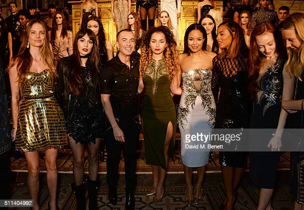 Alicia Rountree Zara Martin Julien Macdonald Ella Eyre Sarah Jane Crawford Rochelle Humes and Olivia Grant pose backstage following the Julien...