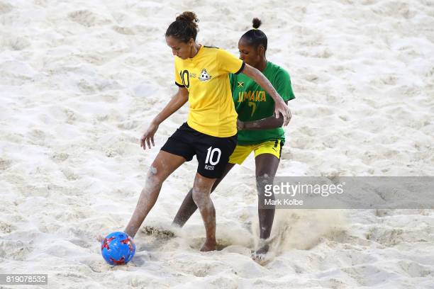 Alicia Telle the Bahamas and Kaveena Howell of Jamaica compete for the ball during the Girls Beach Soccer match 3 between the Bahamas and Jamaica on...