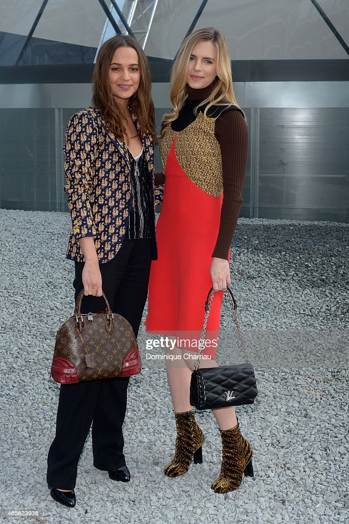 Alicia Vikander and Brit Marling attend the Louis Vuitton show as part of the Paris Fashion Week Womenswear Fall/Winter 2015/2016 on March 11, 2015 in Paris, France.