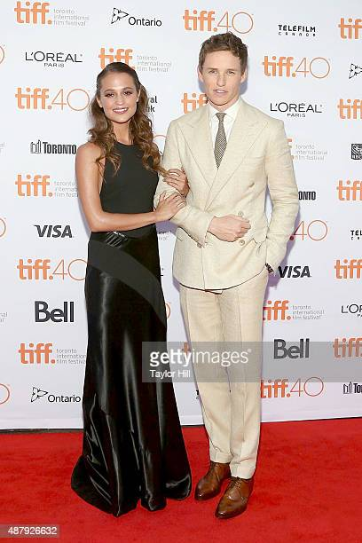 Alicia Vikander and Eddie Redmayne attend the premiere of 'The Danish Girl' at Princess of Wales Theatre during the 2015 Toronto International Film...