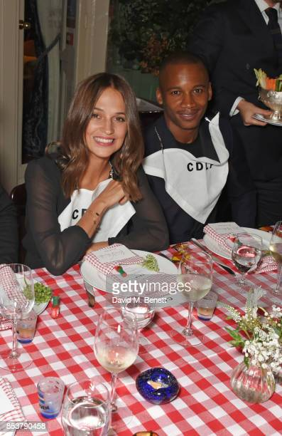 Alicia Vikander and Eric Underwood attend the CDLP Crayfish Party at Mark's Club on September 25 2017 in London England