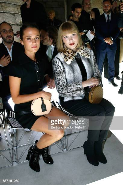 Alicia Vikander and Lea Seydoux attend the Louis Vuitton show as part of the Paris Fashion Week Womenswear Spring/Summer 2018 on October 3 2017 in...