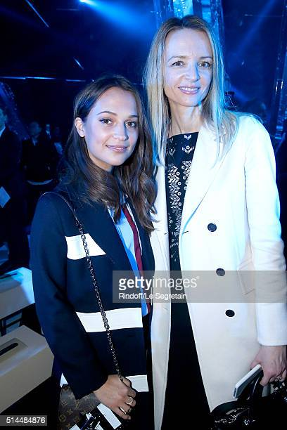 Alicia Vikander and Louis Vuitton's executive vice president Delphine Arnault attend the Louis Vuitton show as part of the Paris Fashion Week...