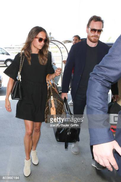 Alicia Vikander and Michael Fassbender are seen at LAX on July 25 2017 in Los Angeles California