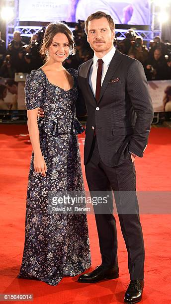 Alicia Vikander and Michael Fassbender attend the UK Premiere of 'The Light Between Oceans' at The Curzon Mayfair on October 19 2016 in London England