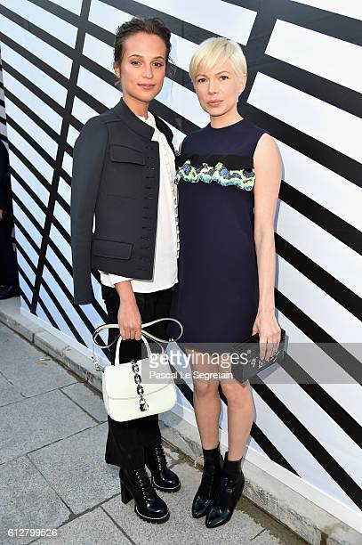 Alicia Vikander and Michelle Williams attend the Louis Vuitton show as part of the Paris Fashion Week Womenswear Spring/Summer 2017 on October 5 2016...