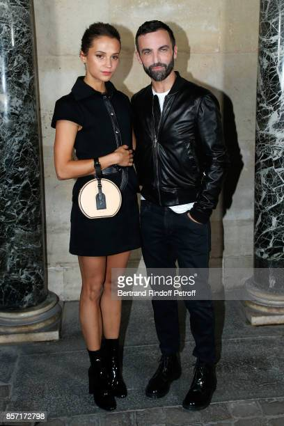 Alicia Vikander and stylist Nicolas Ghesquiere pose after the Louis Vuitton show as part of the Paris Fashion Week Womenswear Spring/Summer 2018 on...