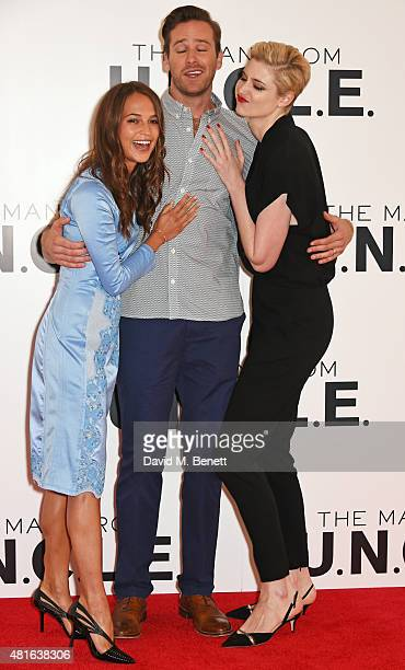 Alicia Vikander Armie Hammer and Elizabeth Debicki attend a photocall for 'The Man From UNCLE' at Claridge's Hotel on July 23 2015 in London England