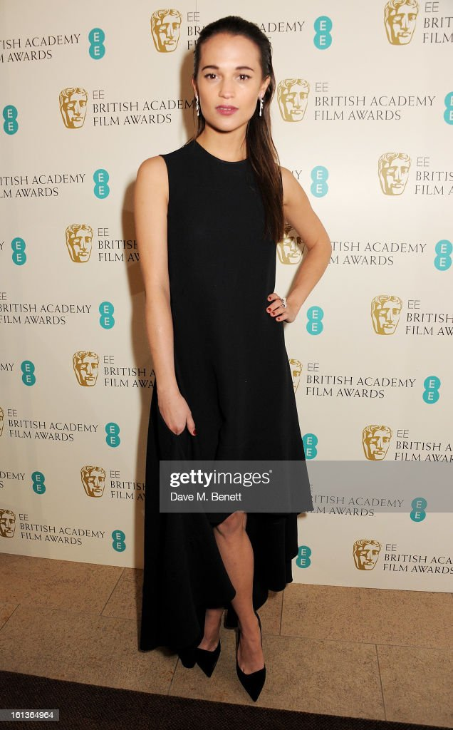 Alicia Vikander arrives at the EE British Academy Film Awards at the Royal Opera House on February 10, 2013 in London, England.