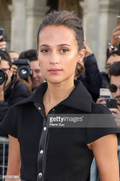 Alicia Vikander arrives at the Louis Vuitton show as part of the Paris Fashion Week Womenswear Spring/Summer 2018 on October 3 2017 in Paris France