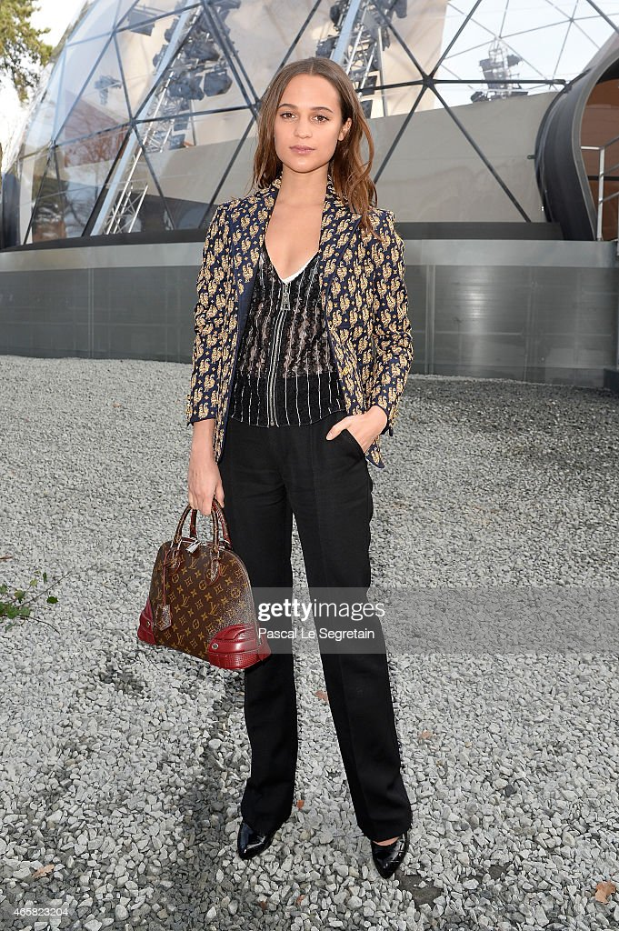 <a gi-track='captionPersonalityLinkClicked' href=/galleries/search?phrase=Alicia+Vikander&family=editorial&specificpeople=7246025 ng-click='$event.stopPropagation()'>Alicia Vikander</a> attends the Louis Vuitton show as part of the Paris Fashion Week Womenswear Fall/Winter 2015/2016 on March 11, 2015 in Paris, France.