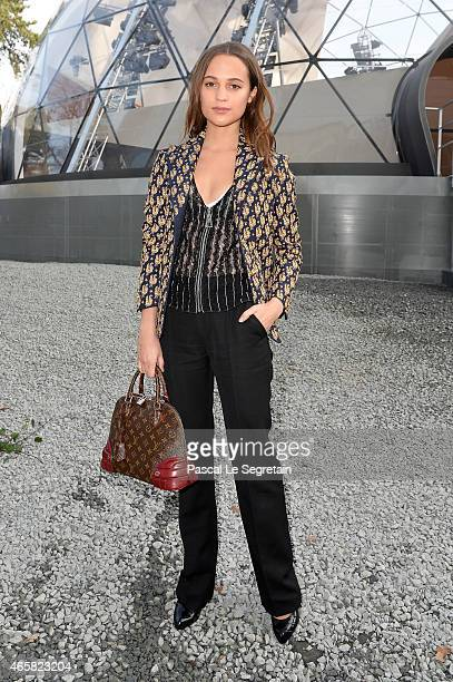 Alicia Vikander attends the Louis Vuitton show as part of the Paris Fashion Week Womenswear Fall/Winter 2015/2016 on March 11 2015 in Paris France