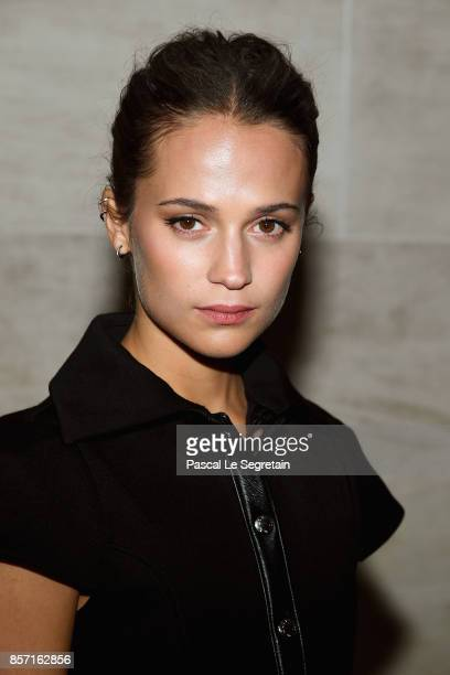 Alicia Vikander attends the Louis Vuitton show as part of the Paris Fashion Week Womenswear Spring/Summer 2018 on October 3 2017 in Paris France