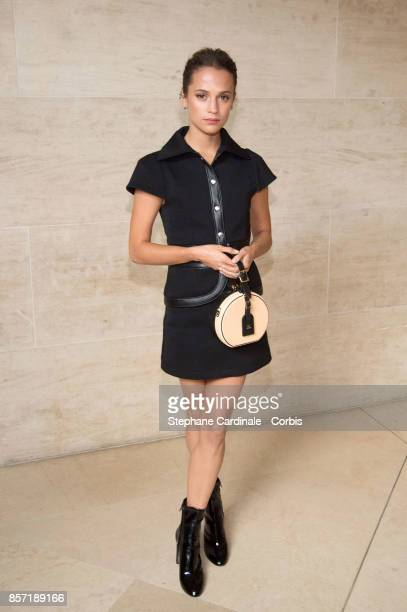 Alicia Vikander attends the Louis Vuitton show as part of the Paris Fashion Week Womenswear Spring/Summer 2018 at Musee du Louvre on October 3 2017...