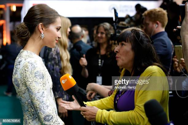 Alicia Vikander gives interviews as she attends the 'Euphoria' premiere during the 13th Zurich Film Festival on September 29 2017 in Zurich...