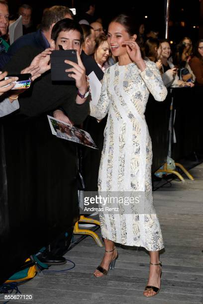 Alicia Vikander takes a selfie with a fan as she attends the 'Euphoria' premiere during the 13th Zurich Film Festival on September 29 2017 in Zurich...