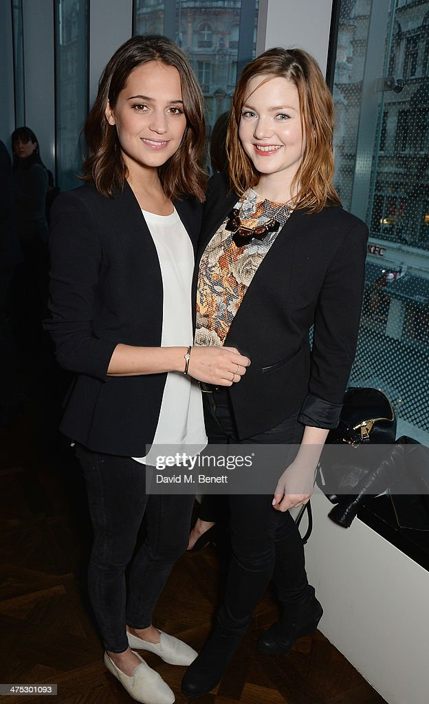 Alicia Vikaner and Holliday Grainger attend a VIP screening of Harvey Weinstein's 'Escape From Planet Earth' at The W Hotel on February 27, 2014 in London, England.