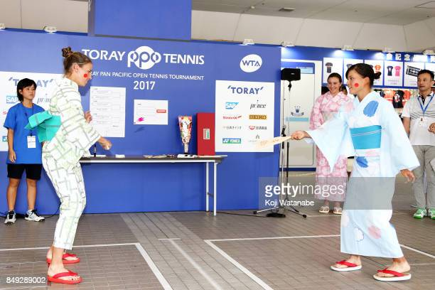 Alicja Rosolska and Makoto Ninomiya wearing Yukata plays Hagoita traditional wooden paddle game during day two of the Toray Pan Pacific Open Tennis...