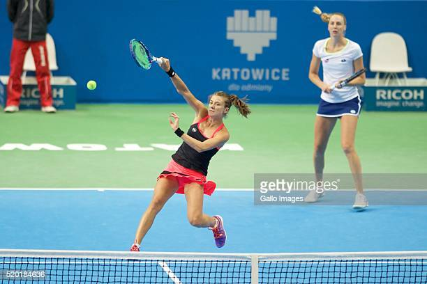 Alicja Rosolska of Poland and Naomi Broady of Great Britain in action during the WTA Katowice Open doubles second semifinal match between Naomi...
