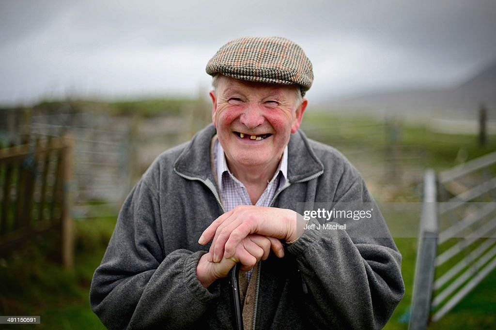 Alick John Morison, smiles after spending a morning dosing sheep on May 15, 2014 in Harris, Scotland. The Isles of Lewis and Harris lie in the Outer Hebrides and make up the largest island in Scotland and stretch for 100 miles. The Isles of Harris and Lewis will vote along with the rest of Scotland in the referendum on whether Scotland should be an independent country on September 18, 2014. Harris and Lewis's economy is a mix of traditional businesses like fishing, weaving and farming, with more recent influence of tourism, the popularity of Harris and Lewis has grown steadily over recent years.