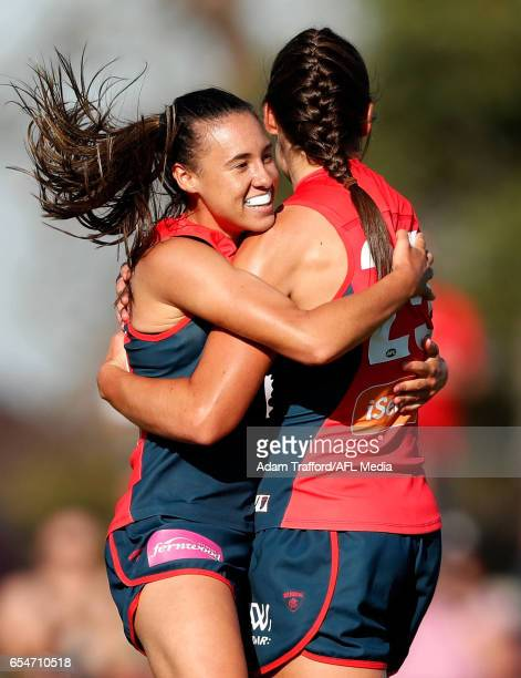 Aliesha Newman of the Demons celebrates a goal with Madeleine Boyd of the Demons during the 2017 AFLW Round 07 match between the Melbourne Demons and...