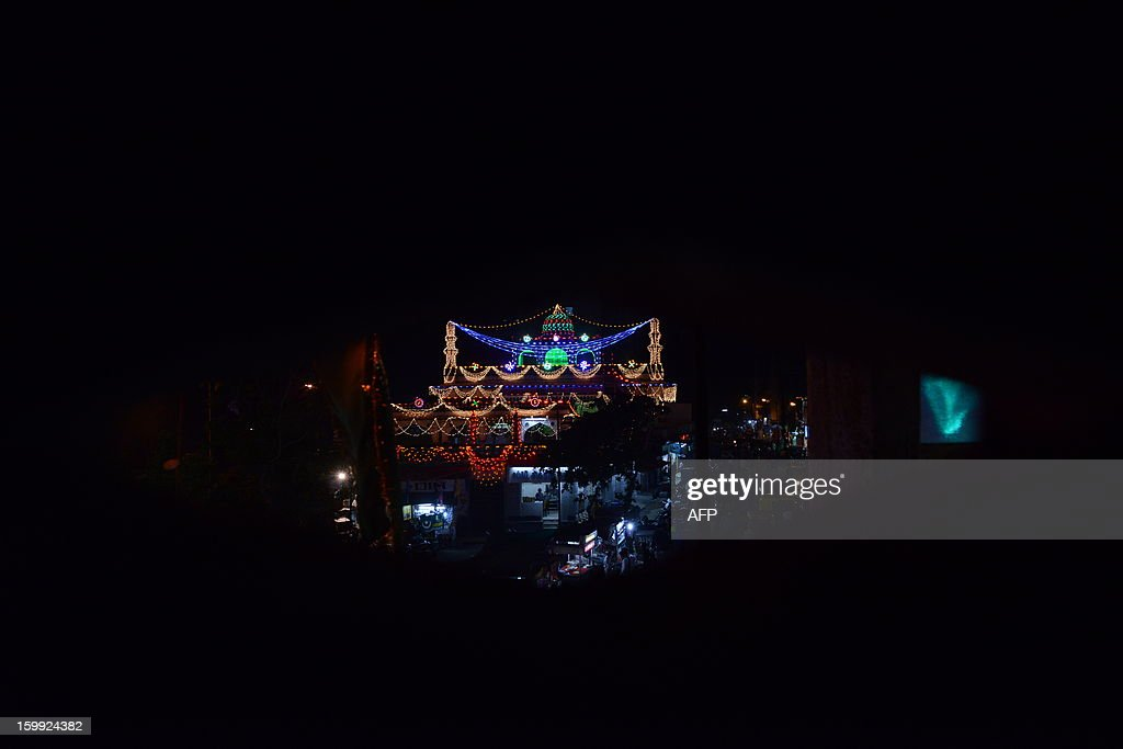 Alif Ki Masjid is illuminated ahead of Eid Milad-un-Nabi (Birth of the Prophet) in the Walled City of Ahmedabad on late January 23, 2013. Muslims across India and the globe will celebrate Eid-Un-Nabi, the birthday of prophet Muhammad on January 25. AFP PHOTO / Sam PANTHAKY