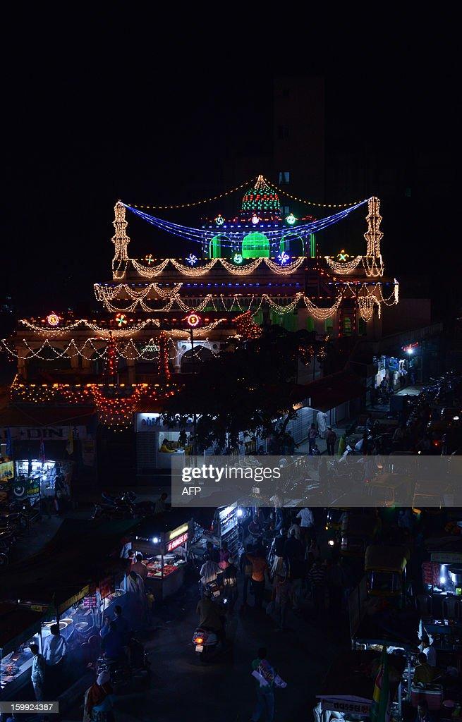 Alif Ki Masjid is illuminated ahead of Eid Milad-un-Nabi (Birth of the Prophet) in the Walled City of Ahmedabad on late January 23, 2013. Muslims across India and the globe will celebrate Eid-Un-Nabi, the birthday of prophet Muhammad on January 25. AFP PHOTO / Sam PANTHAKY