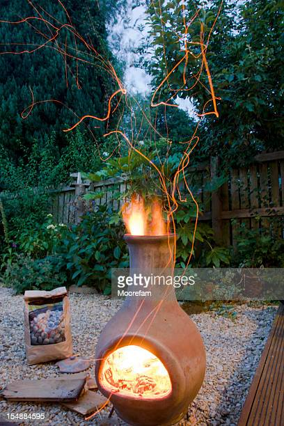 Alight chimnea and sparks in the back garden