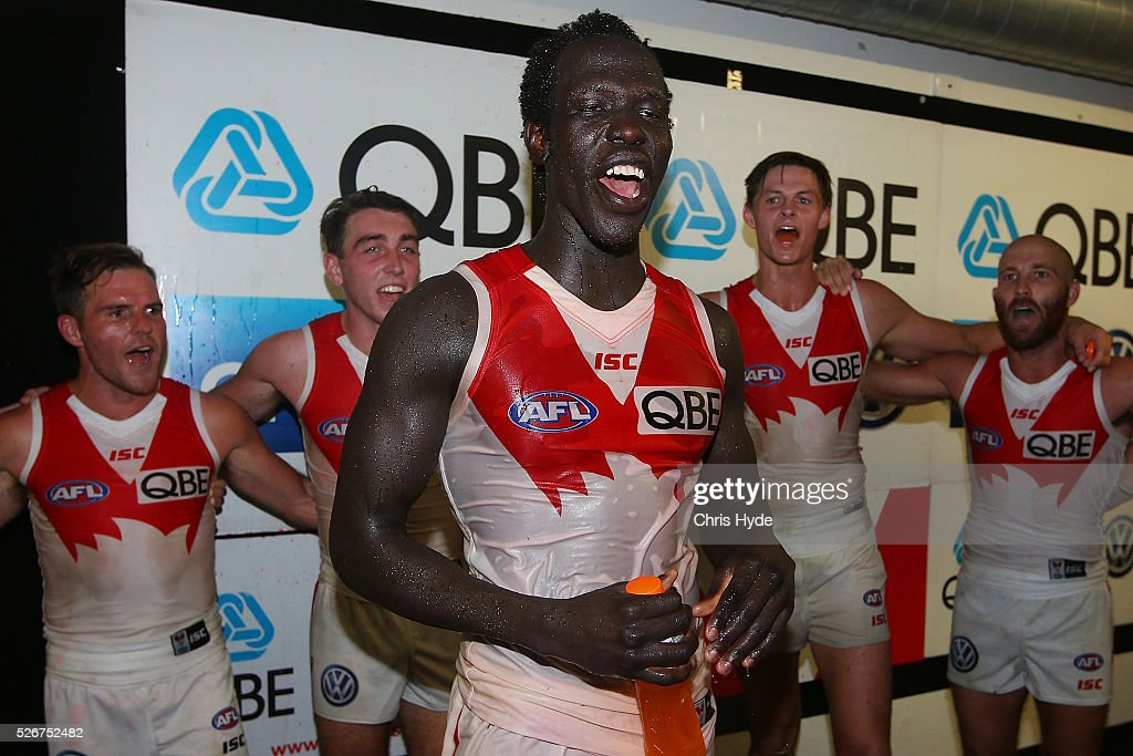 Aliir Aliir of the Swans sings the team song after winning the round six AFL match between the Brisbane Lions and the Sydney Swans at The Gabba on May 1, 2016 in Brisbane, Australia.