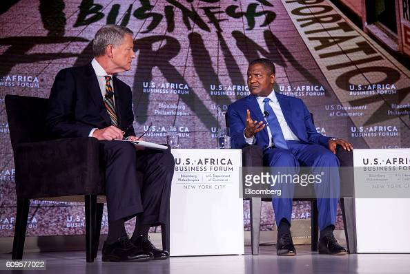 Aliko Dangote president and chief executive officer of Dangote Sugar Refinery Plc right speaks during the US Africa Business Forum in New York US on...