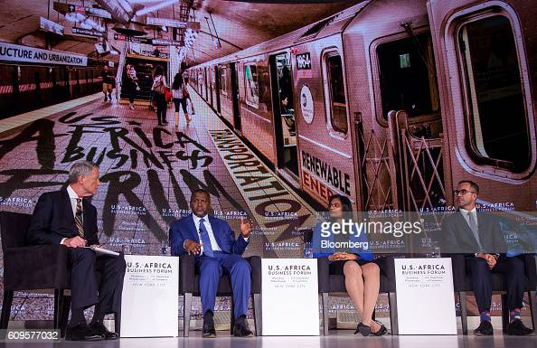 Aliko Dangote president and chief executive officer of Dangote Sugar Refinery Plc from second left Jasandra Nyker chief executive officer of BioTherm...