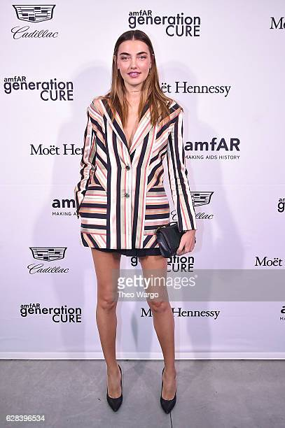 Alina Baikova attends the 2016 amfAR GenerationCure Holiday Party at Cadillac House on December 7 2016 in New York City