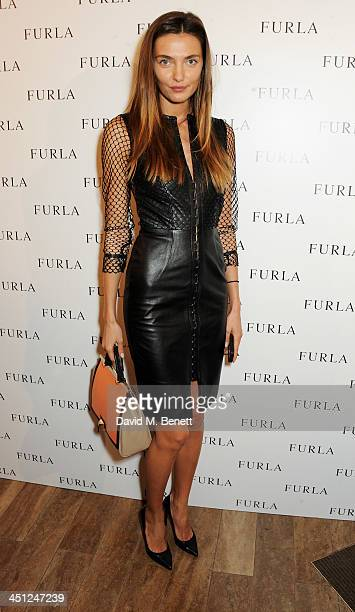 Alina Baikova attends the Furla flagship store reopening on November 21 2013 in London England