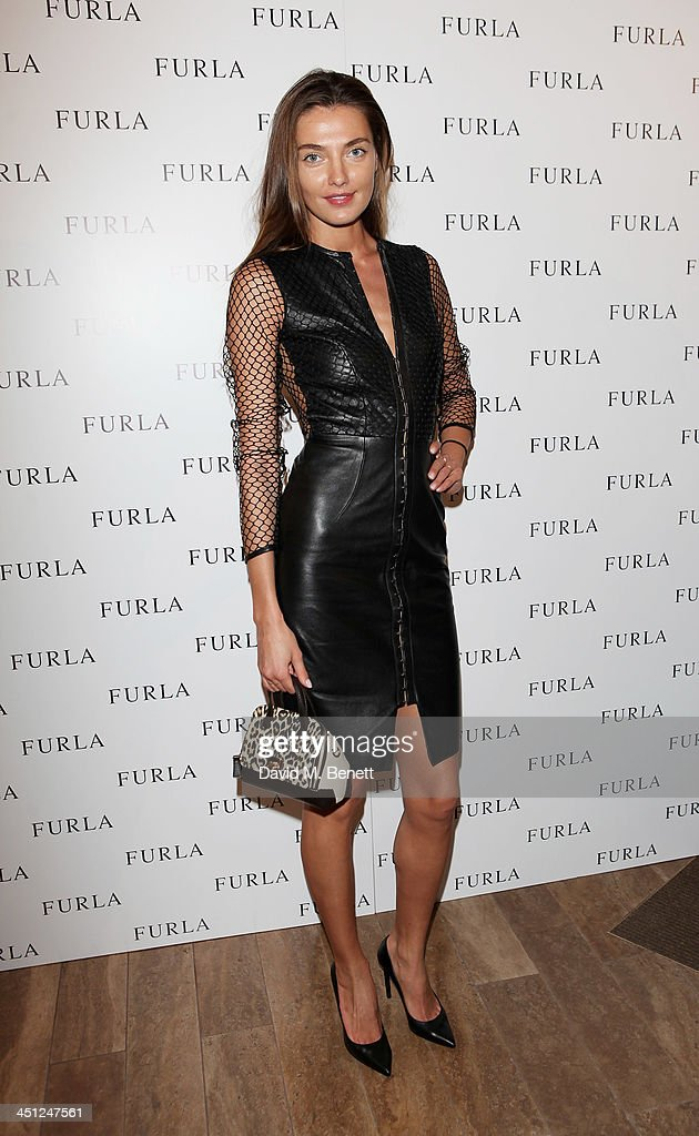 Alina Baikova attends the Furla flagship store re-opening on November 21, 2013 in London, England.