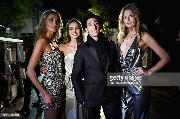 Alina Baikova Lara Leito Adrian Brody and Toni Garrn pose backstage at the amfAR's 23rd Cinema Against AIDS Gala at Hotel du CapEdenRoc on May 19...