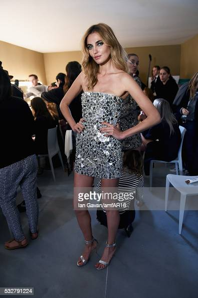 Alina Baikova prepares backstage at the amfAR's 23rd Cinema Against AIDS Gala at Hotel du CapEdenRoc on May 19 2016 in Cap d'Antibes France