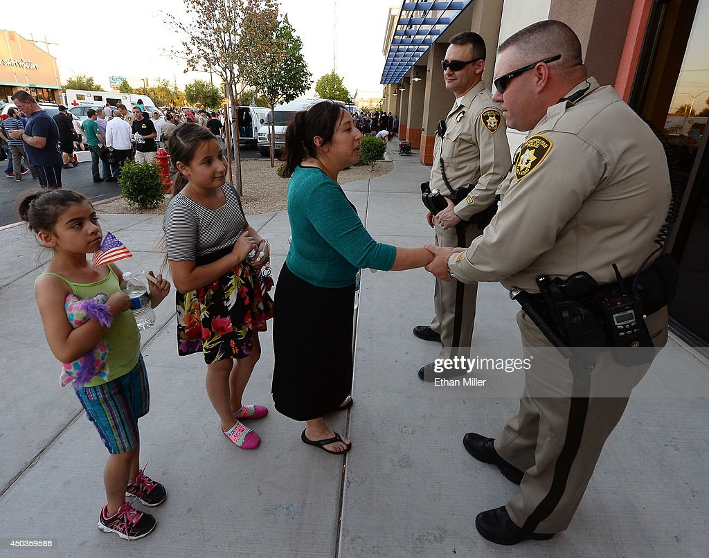 Alina Gamboa, Kaylie Salis and Aurora Espinoza, all of Nevada, greet Las Vegas Metropolitan Police Department officers Scott Wildermuth and Brandon Shatraw during a vigil outside CiCi's Pizza on June 9, 2014 in Las Vegas, Nevada. The Las Vegas Metropolitan Police Department says officers Alyn Beck and Igor Soldo were shot and killed yesterday at the restaurant by Jerad Miller and his wife Amanda Miller. Police say the Millers then went into a nearby Wal-Mart where Amanda Miller killed Joseph Wilcox before the Millers killed themselves.