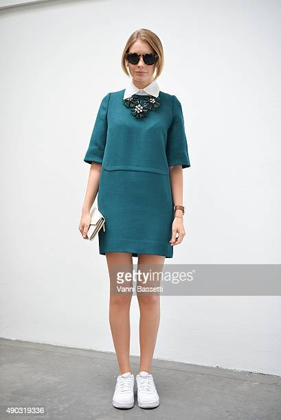 Alina Gelzina poses wearing a Marni dress and Nike shoes after the Marni show during the Milan Fashion Week Spring/Summer 2016 on September 27 2015...